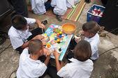 YALA-YAHA, THAILAND - NOVEMBER 8: Unidentified male kids paint c — Stock Photo