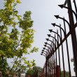 Stock Photo: Strong fence with prickle metal on wall