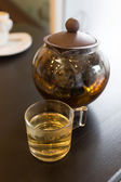 Brown hot tea pot on table — Stock Photo
