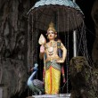 Hindu deity statue above entrance of Batu Caves — Stock Photo #31185317