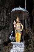 Hindu deity statue above entrance of Batu Caves — Stock Photo