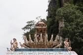 Hindu deity statue above pavilion — Stock Photo