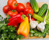 Vitamin set of vegetables from tomatoes cucumbers parsley pepper — Stock Photo