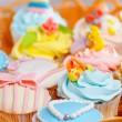 Cupcakes in a basket - Stock Photo
