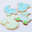 Cookies in the shape of the pram and clothes — Stock Photo
