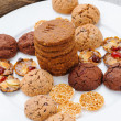 Stock Photo: Many different types of cookies lay on plate