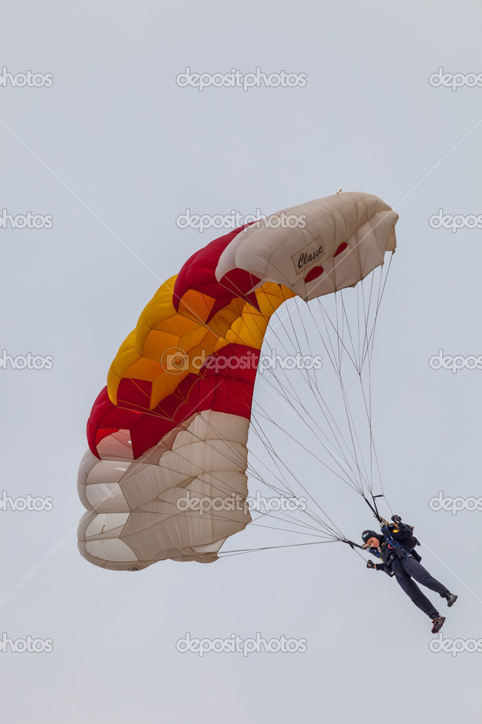 CADIZ, SPAIN-SEP 13:  Parachutist of the PAPEA taking part in an exhibition on the 2nd airshow of Cadiz on Sep 13, 2009, in Cadiz, Spain  Stock Photo #13887412