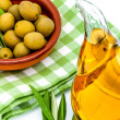 Green olives and olive oil — Stock Photo #14260579