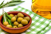 Green olives and olive oil — Stock Photo