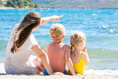 Mother with her children by the sea — Stock Photo