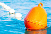 Buoy with swimming lane marker in water — Stock Photo