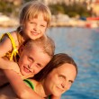 Happy family by the sea — Stock Photo