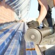 Construction worker sawing steel sheet — Stockfoto