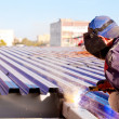 Industrial worker during welding works - 图库照片
