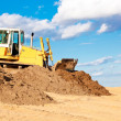 Royalty-Free Stock Photo: Bulldozer moving soil at construction site