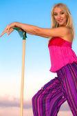 Blonde girl with gardening tool — Stock Photo