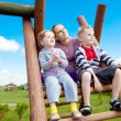 Happy family at park playground — Stock Photo