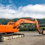 Excavator at construction site — Stock Photo