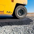 Stock Photo: Road roller leveling fresh asphalt pavement