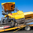Transportation tracked paver machine — Stock Photo