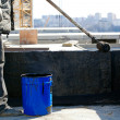 Stock Photo: Roofer painting black coal tar at concrete surface
