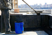 Roofer painting black coal tar at concrete surface — Stock Photo