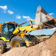 Excavator machine unloading sand with water — Stock Photo #26524151