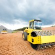 Stock Photo: Road roller and bulldozer during construction works