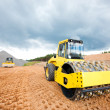 Road roller and bulldozer during construction works — Stock Photo #28644929