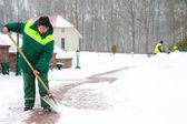 Worker shoveling snow — Stock Photo