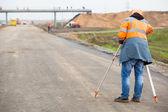 Surveyor engineer making measuring with theodolite — Stock Photo