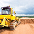 Stock Photo: Bulldozer during road works