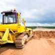 Bulldozer during road works — Stock Photo