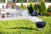 Cooking with kettle barbecue — Stock Photo