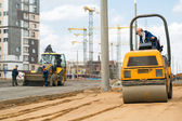 Road roller compacting sand during road works — Stock Photo