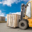 Forklift truck transporting wood cargo box — Stock Photo #46498931