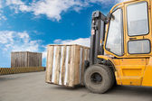Forklift truck transporting wood cargo box — Stock Photo