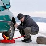 Man driver repairing car at the road — Stock Photo #8712260