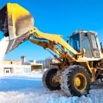 Wheel loader machine unloading snow — Stock Photo #9016929