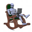 Robot in an arm-chair with a notebook — Stock Photo
