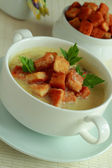 Hot soup with toasts in a bowl — Stockfoto