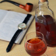 Royalty-Free Stock Photo: Glass with cognac and notebook