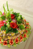 Salad Olivier decorated by roses — Stock Photo