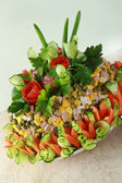 Salad Olivier decorated by flowers — Stock Photo