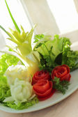 Bouquet from tomato and onion — Stock Photo