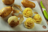 Yellow roses made from a potato — Stock Photo
