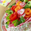 Lettuce of Olivier is decorated by flowers — Stock Photo