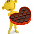 Stock Photo: Yellow mwith box of chocolate candies