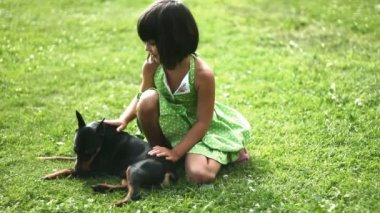 Girl and dog on grass 1 new — Stock Video