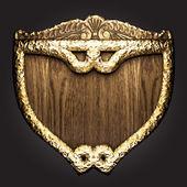 Golden vector shield — Stock Vector